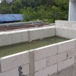 pool around concrete wall