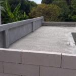 hard stone brick around new swimming pool where already raining water