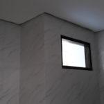toilet window installation. tolilet need still final paint and window frames
